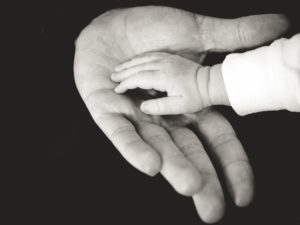 dad baby hands bw